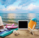Beach accessories and photos on the memory on a background of se Royalty Free Stock Photography