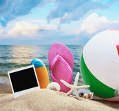 Beach accessories and photos on the memory Royalty Free Stock Photo