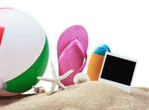 Beach accessories and photos on memory isolated Stock Photography