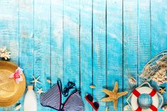 Beach accessories placed on blue wooden planks, top view. Royalty Free Stock Photography