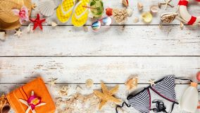 Beach accessories placed on white wooden planks, top view. Stock Images