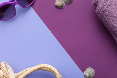 Beach Accessories on Purple Background Royalty Free Stock Photography