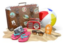 Beach accessories for relaxing. Sunscreen bottle, flip flops, su Royalty Free Stock Image