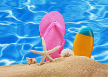 Beach accessories in the sand Stock Photography