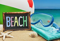 Beach accessories in the sand Stock Image