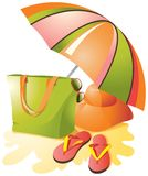 Beach accessories on the sand under the umbrella. vector illustration