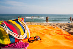 Beach accessories on the sandy shore of the sea Royalty Free Stock Photography