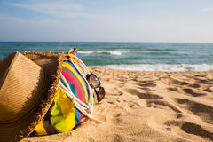 Beach accessories on the sandy shore of the sea Royalty Free Stock Photos