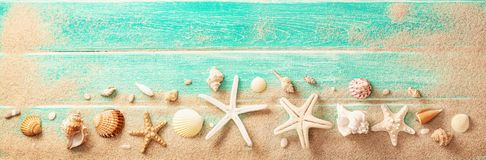 Beach Accessories With Seashells On Wooden Board Royalty Free Stock Image