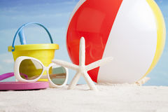 Beach accessories with starfish and beach ball Royalty Free Stock Photos