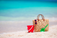 Beach accessories - straw bag, headphones, beach kids toys and sunglasses on the beach Stock Photos