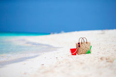 Beach accessories - straw bag, headphones, beach kids toys and sunglasses on the beach Royalty Free Stock Photo