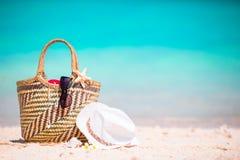 Beach accessories - straw bag, sunglasses, hat on the beach Stock Photo