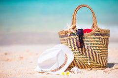 Beach accessories - straw bag, sunglasses, hat on the beach Royalty Free Stock Images