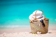 Beach accessories - straw bag, sunglasses, hat on the beach Royalty Free Stock Photos