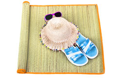 Beach accessories on straw mat over white Stock Photo