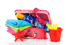 Beach  accessories and suitcase over white background Royalty Free Stock Photo