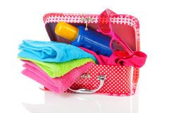 Beach  accessories and suitcase over white background Stock Photos