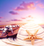Beach accessories on sunset Royalty Free Stock Photos
