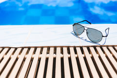 Beach accessories by the swimming pool Royalty Free Stock Photography