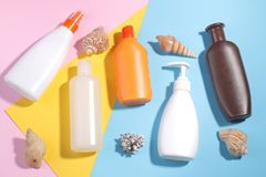 Beach accessories. Various creams and lotions, for sunburn, from sunburn, on a bright colored background. Top view. Beach accessories. Various creams and lotions Stock Image