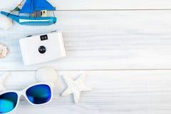 Beach accessories White sunglasses,starfish,camera,boat,shell Royalty Free Stock Photography