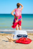 Beach accessories, woman in the background Royalty Free Stock Photo