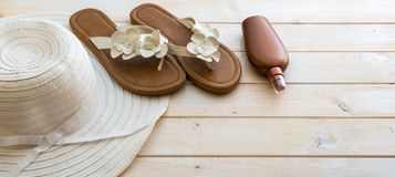 Beach accessories on a  wooden background Stock Images