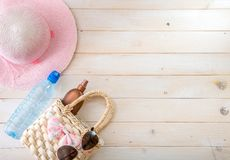 Beach accessories on a  wooden background Royalty Free Stock Photography