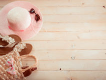 Beach accessories on a  wooden background Royalty Free Stock Photo