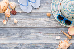 Beach accessories on wooden board. Royalty Free Stock Photography