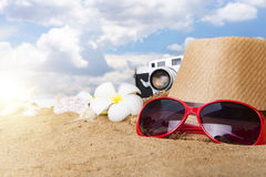 Beach accessories on wooden board,Straw hat,sunglasses on wood Royalty Free Stock Image