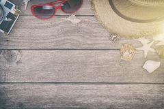 Beach accessories on wooden board,Straw hat,sunglasses on wood Royalty Free Stock Photos