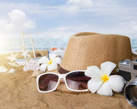 Beach accessories on wooden board,Straw hat,sunglasses on wood Stock Image