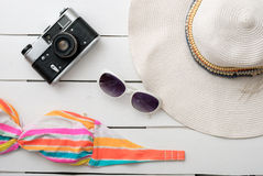 Beach accessories on wooden board Royalty Free Stock Images