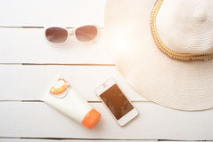 Beach accessories on wooden board Stock Photos