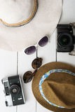 Beach accessories on wooden board Royalty Free Stock Photos