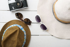 Beach accessories on wooden board Royalty Free Stock Photo