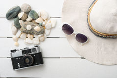 Beach accessories on wooden board Royalty Free Stock Photography