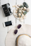 Beach accessories on wooden board Stock Photo