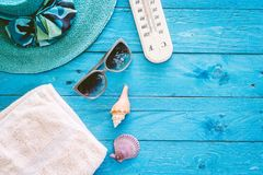 Beach accessories on wooden table royalty free stock image