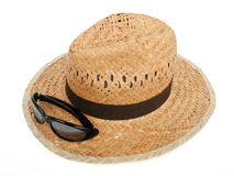 Beach accessories. Woven hat and sun glasses on white background Stock Image