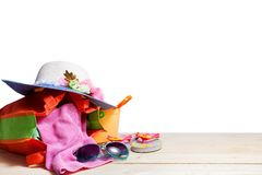 Beach accessory,sunglasses, flip-flops,hat,cloths,on wooden floo Royalty Free Stock Photos