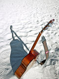 Beach Acoustic Music. An acoustic guitar standing in the sandy beach royalty free stock image