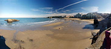 Beach activity during low tide at Biarritz. Panorama of beach activity during low tide at Biarritz in southern France Royalty Free Stock Photos