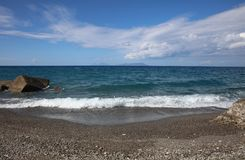 Beach with Aeolian Islands on Sicily Royalty Free Stock Photography
