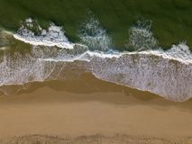 Beach on aerial drone top view with ocean waves reaching shore royalty free stock photo