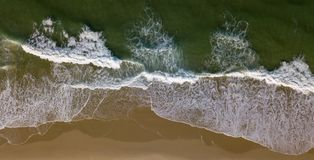 Beach on aerial drone top view with ocean waves reaching shore. France, Aquitaine stock images