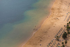 Beach aerial - ocean, sand and people at beach Royalty Free Stock Photography