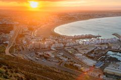 Beach in Agadir city at sunrise, Morocco Stock Images